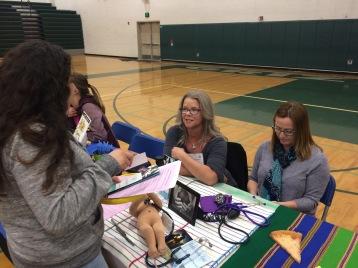 Kelly & Tari talking with students at career fair